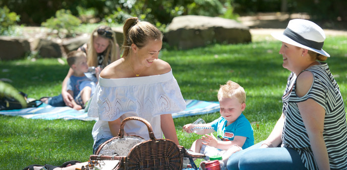 Women and toddlers enjoying a picnic at Healesville Sanctuary.